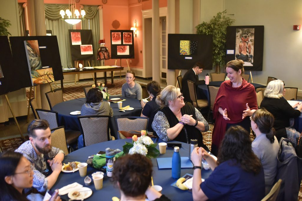 women eating and talking at event event planning ann arbor event management ann arbor conference planning ann arbor conference management ann arbor