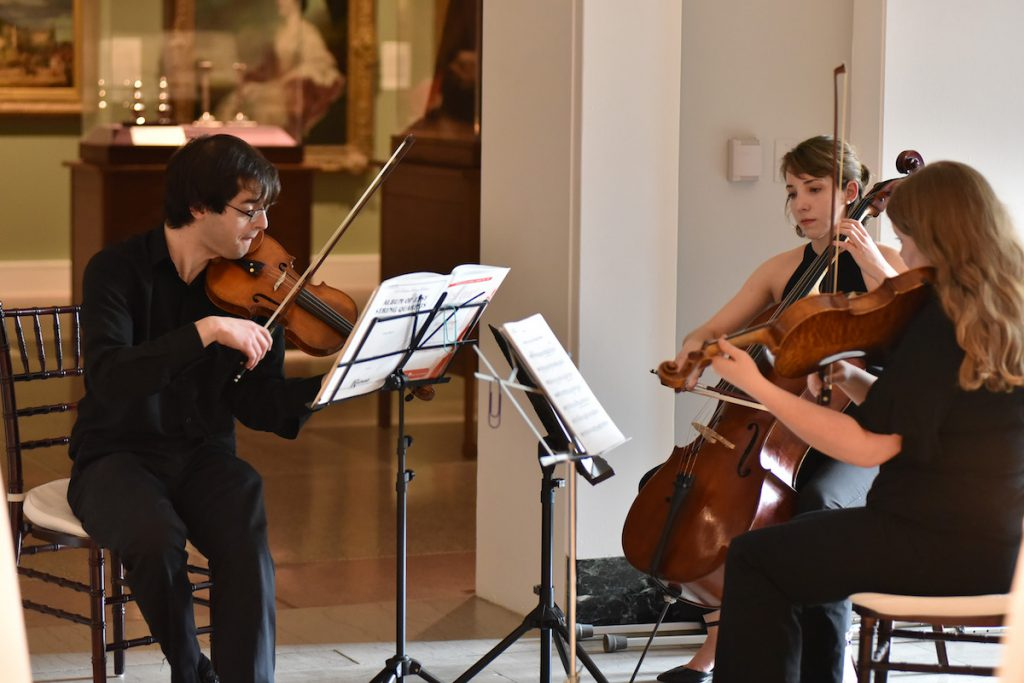 string quartet playing at event